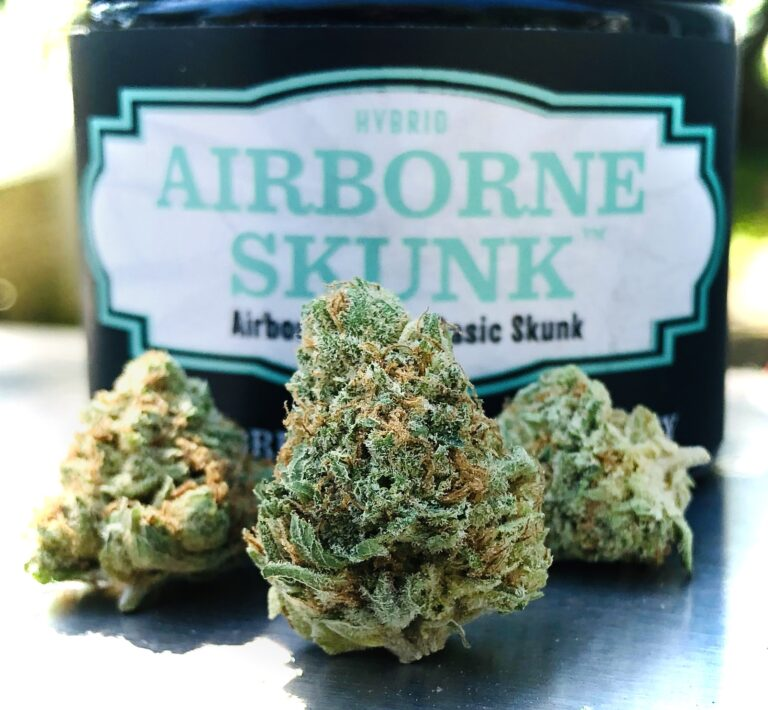 three buds of airborne skunk with evermore container behind