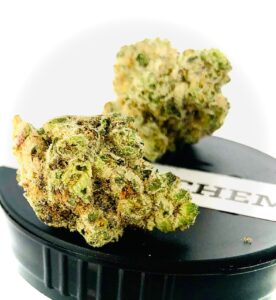 two buds of cake & chem on black stane container lid