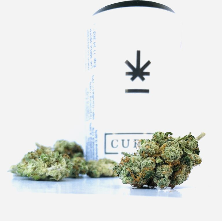 bud of mk ultra strain with curio container in background