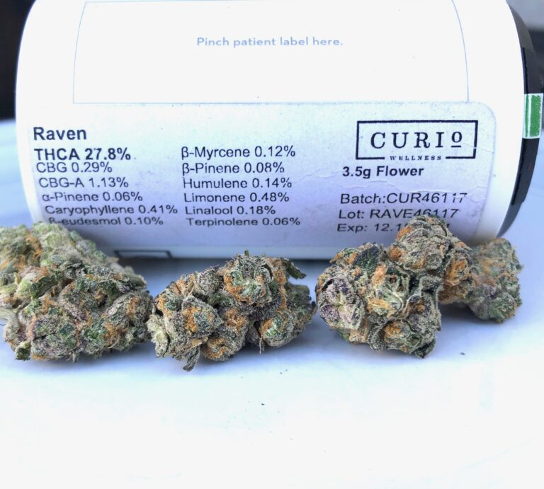 raven by curio terpene and potency label with buds in foreground
