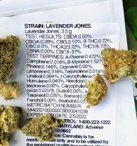 detail of lavender jones terpene testing label with buds scattered around