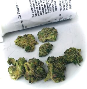 buds of cookie face in front of white pre pack bottle